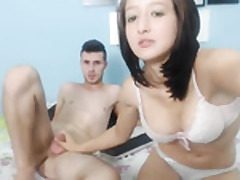 Youthful dark-haired teenage performs footjob and romp