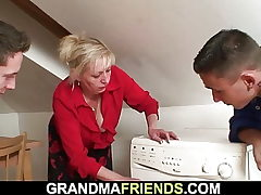 Two repairmen pulverize old light-haired grandma