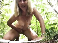 Mature nasty blond is fapping her pussy hole right outdoors