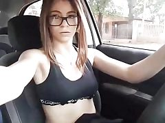 Teen honey is driving a car and showcases her small natural boobs