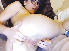 Sexy chick is stimulating her both holes finger-banging them seductively