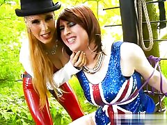 Horny chicks dressed for 4th of July sexually manhandling a man in the forest