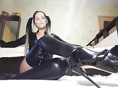 Hot cockslut on high high-heeled slippers and leather costume touching her super-naughty cooch hole