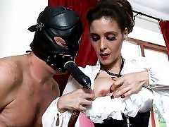 Nasty man is dressed in a ebony leather mask romping her mouth
