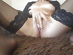 Gigantic butt woman is caressing her dousing moist vag in front of the camera, just for joy