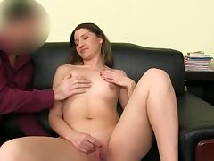 Scorching stunner undresses nude and thumbs her smooth-shaven labia fuck hole